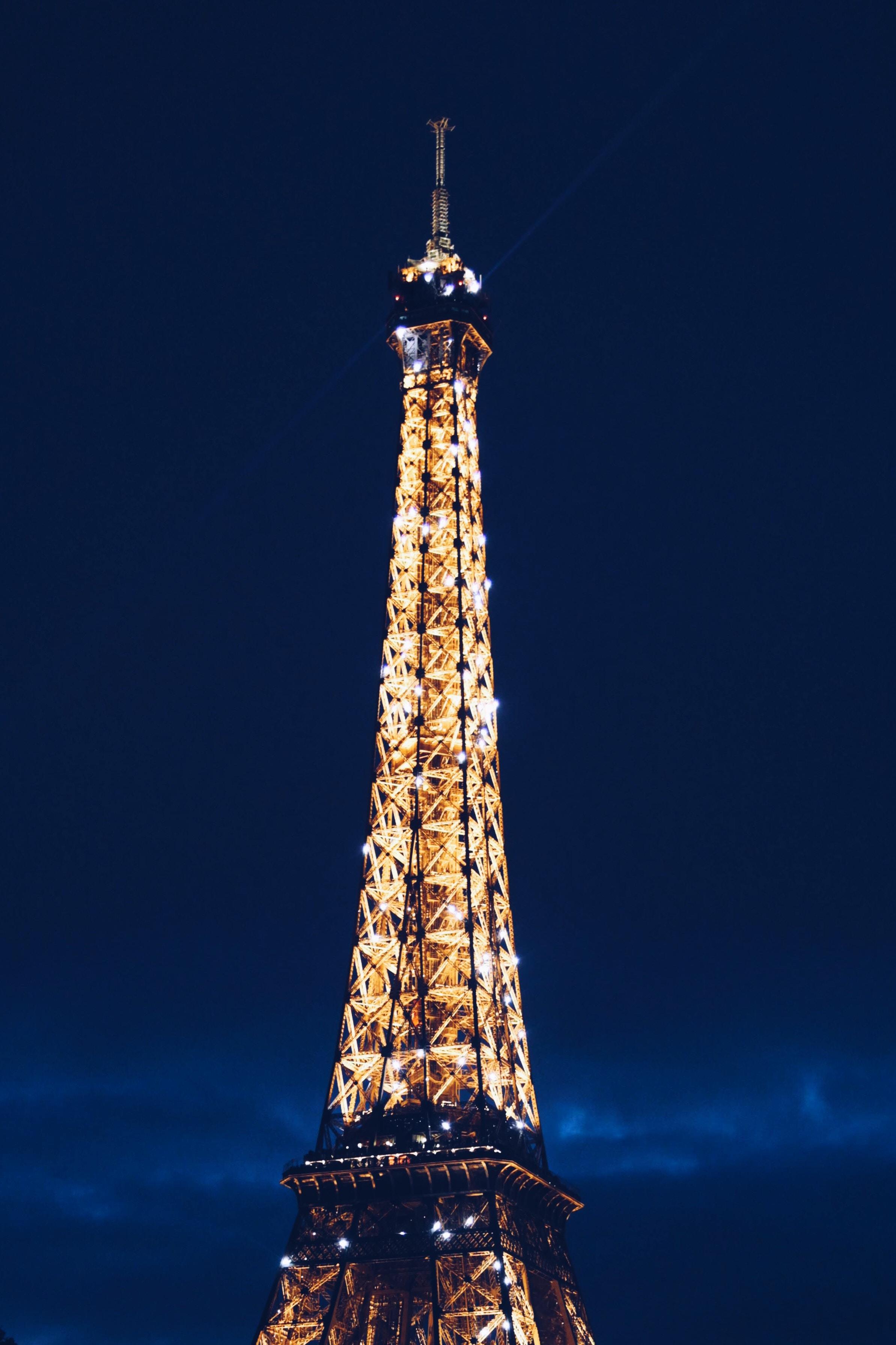 The historic Eiffel Tower illuminated at night.