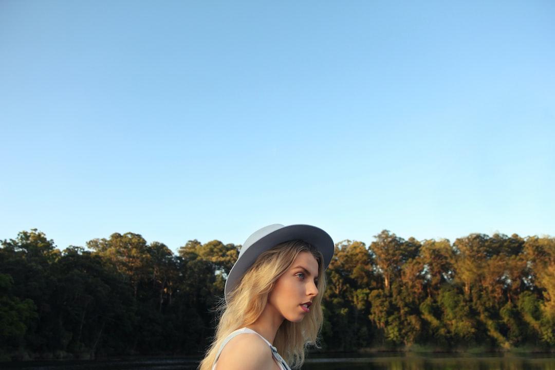 Blonde model near autumn trees