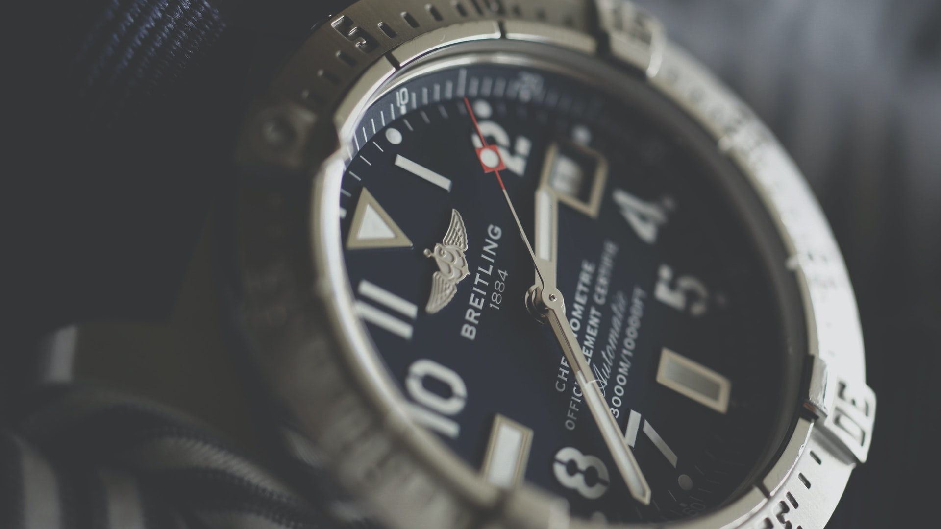 The face of an elegant Breitling watch in close-up