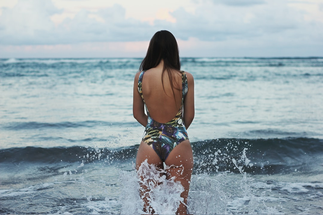 Woman standing in swimsuit