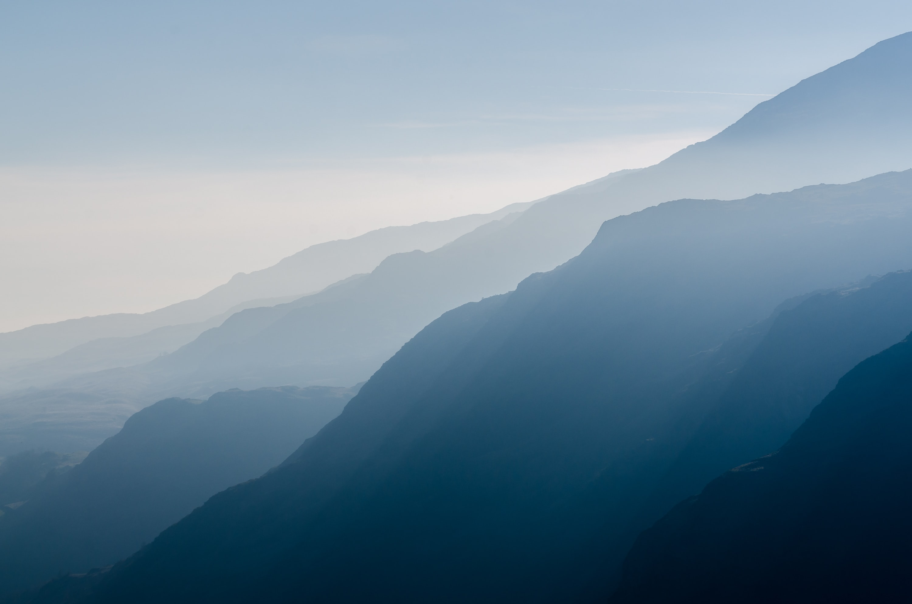 Mac Wallpapers  C B Haze Over Steeply Descending Mountain Ridges