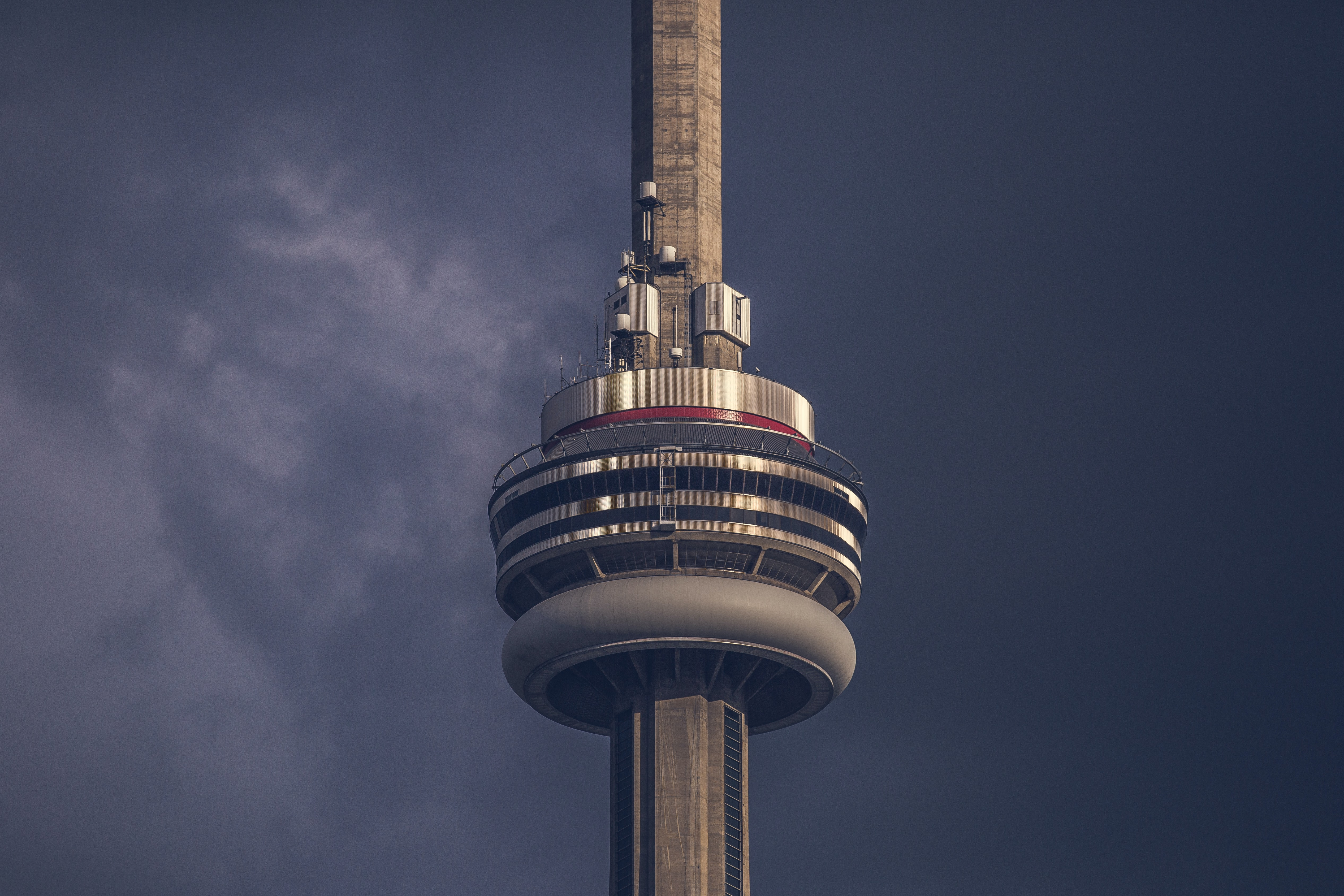 Toronto's CN Tower building on a dark gray sky