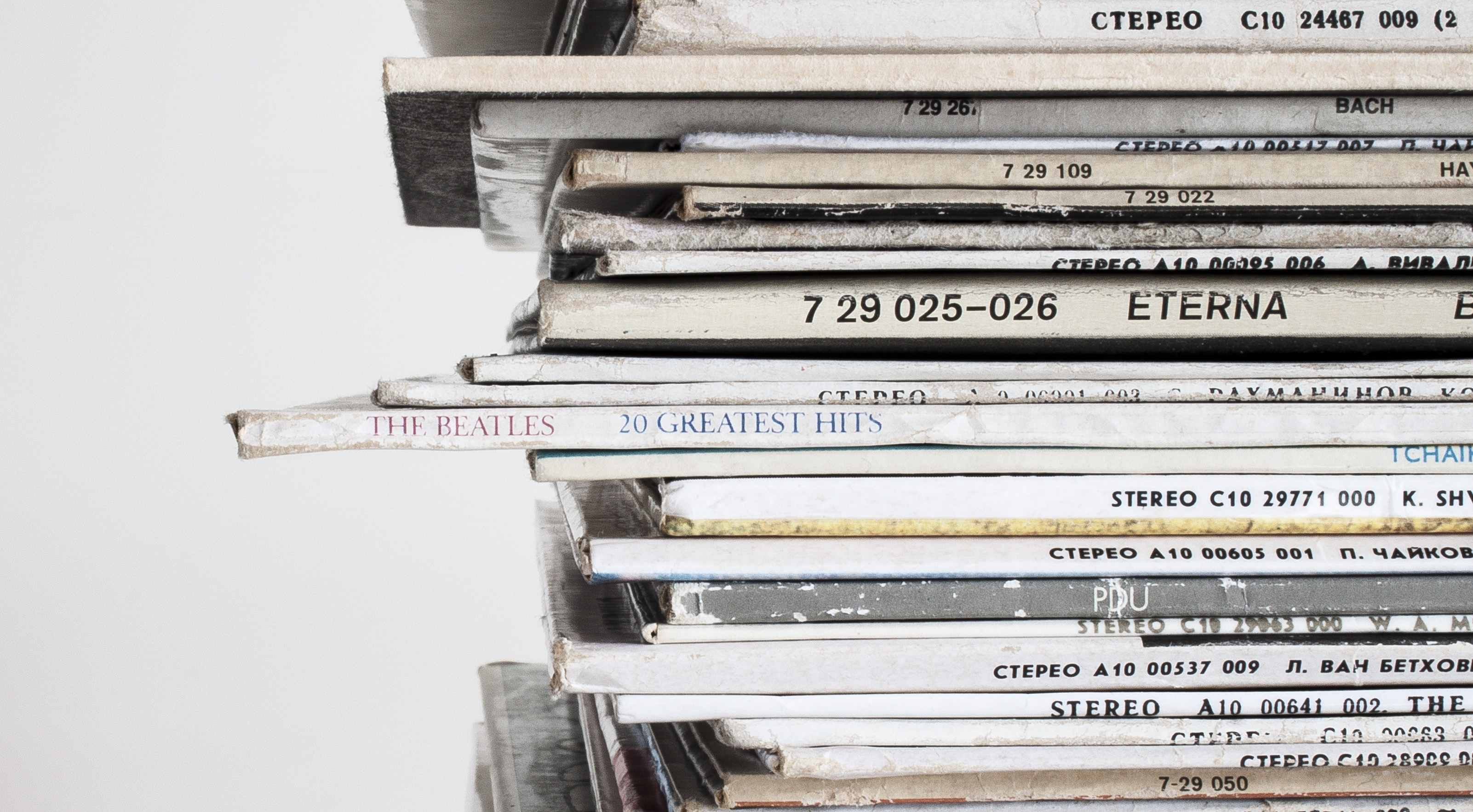 A close-up of a stack of old vinyl records
