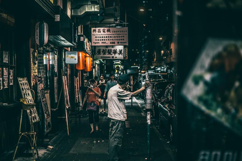people on street between stores
