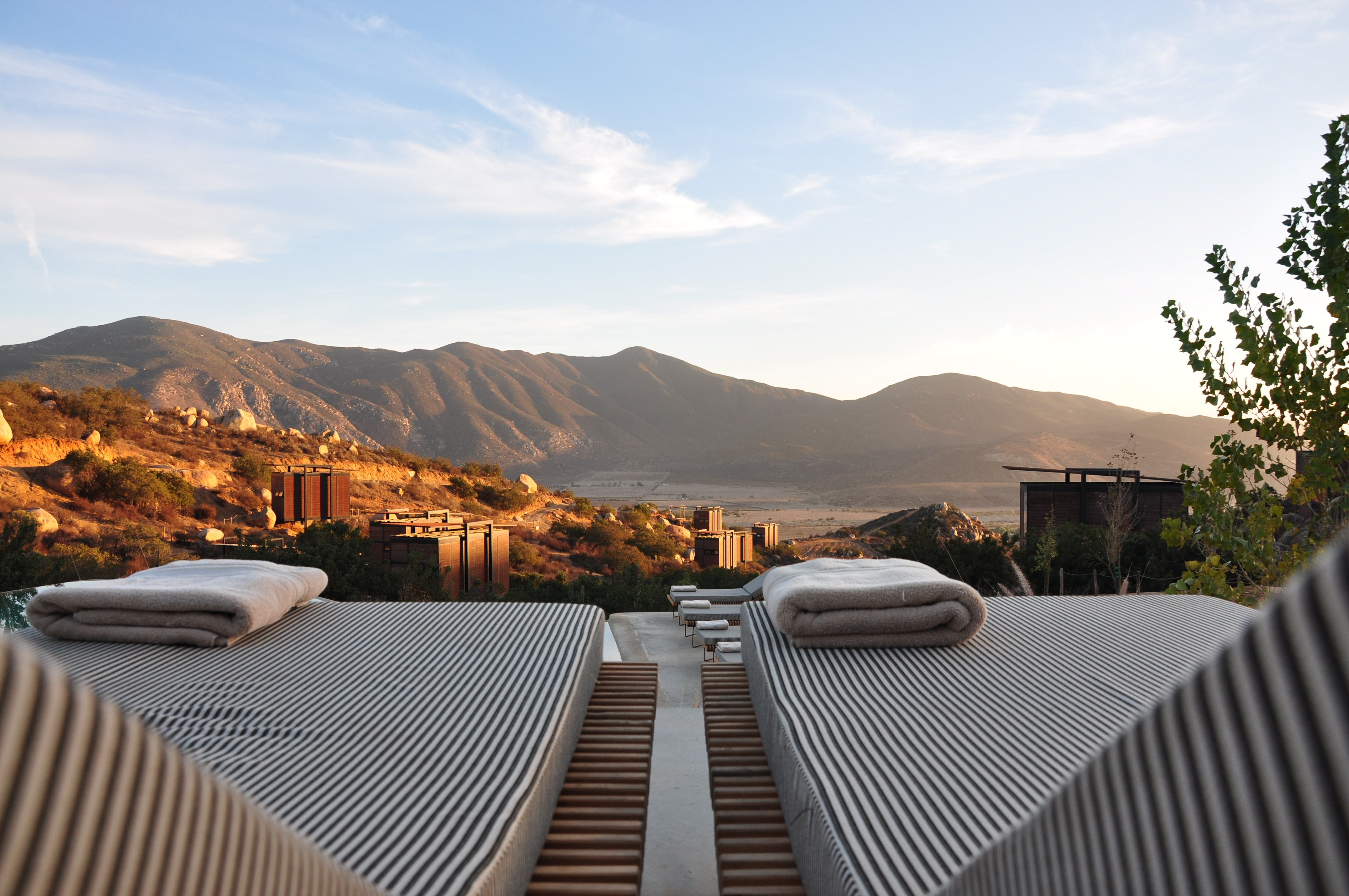 sunloungers fronting buildings near mountain