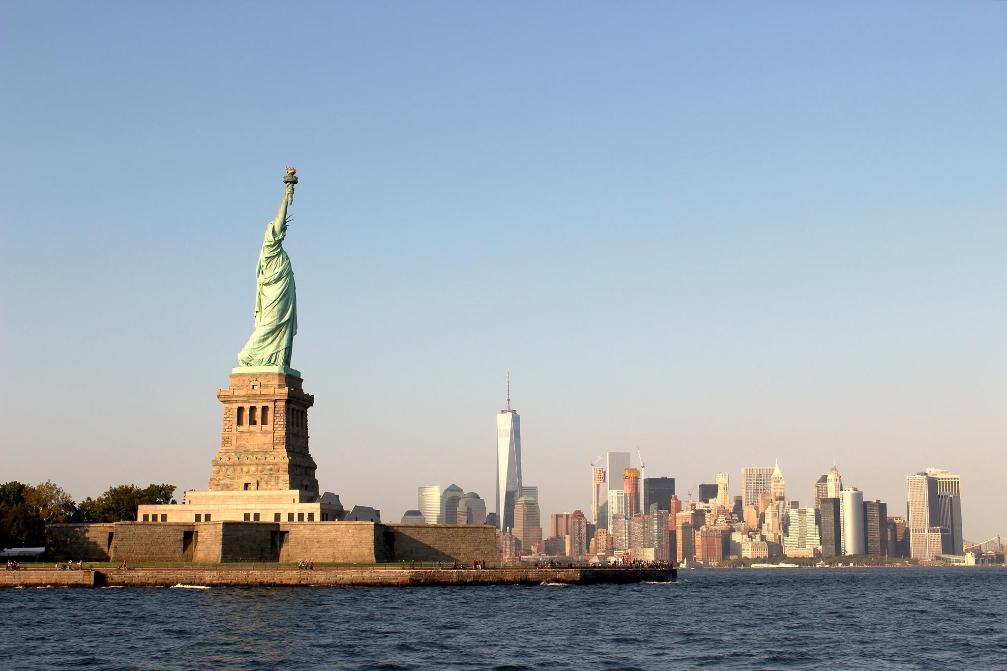 The Statue of Liberty with the New York City Financial District skyline in the distance