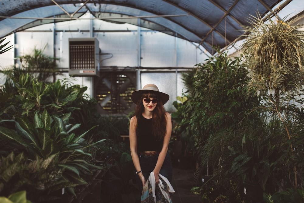 woman standing in between plants