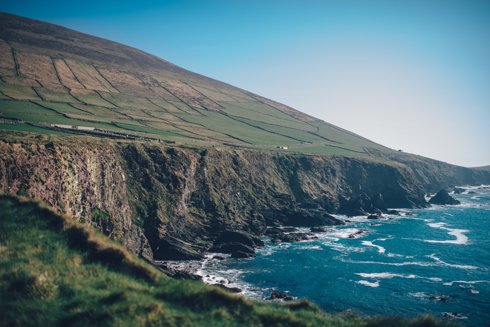 landscape photography of cliff under blue sky