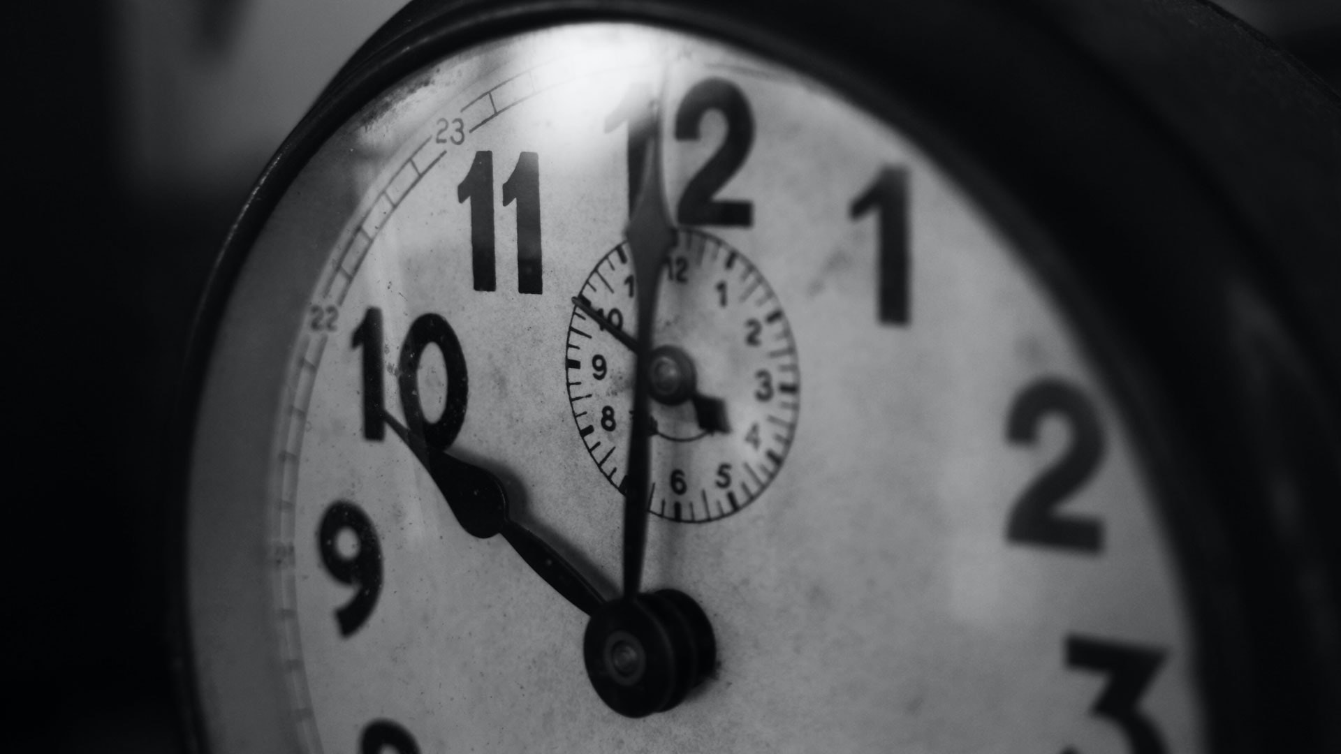 grayscale photography of pocket watch