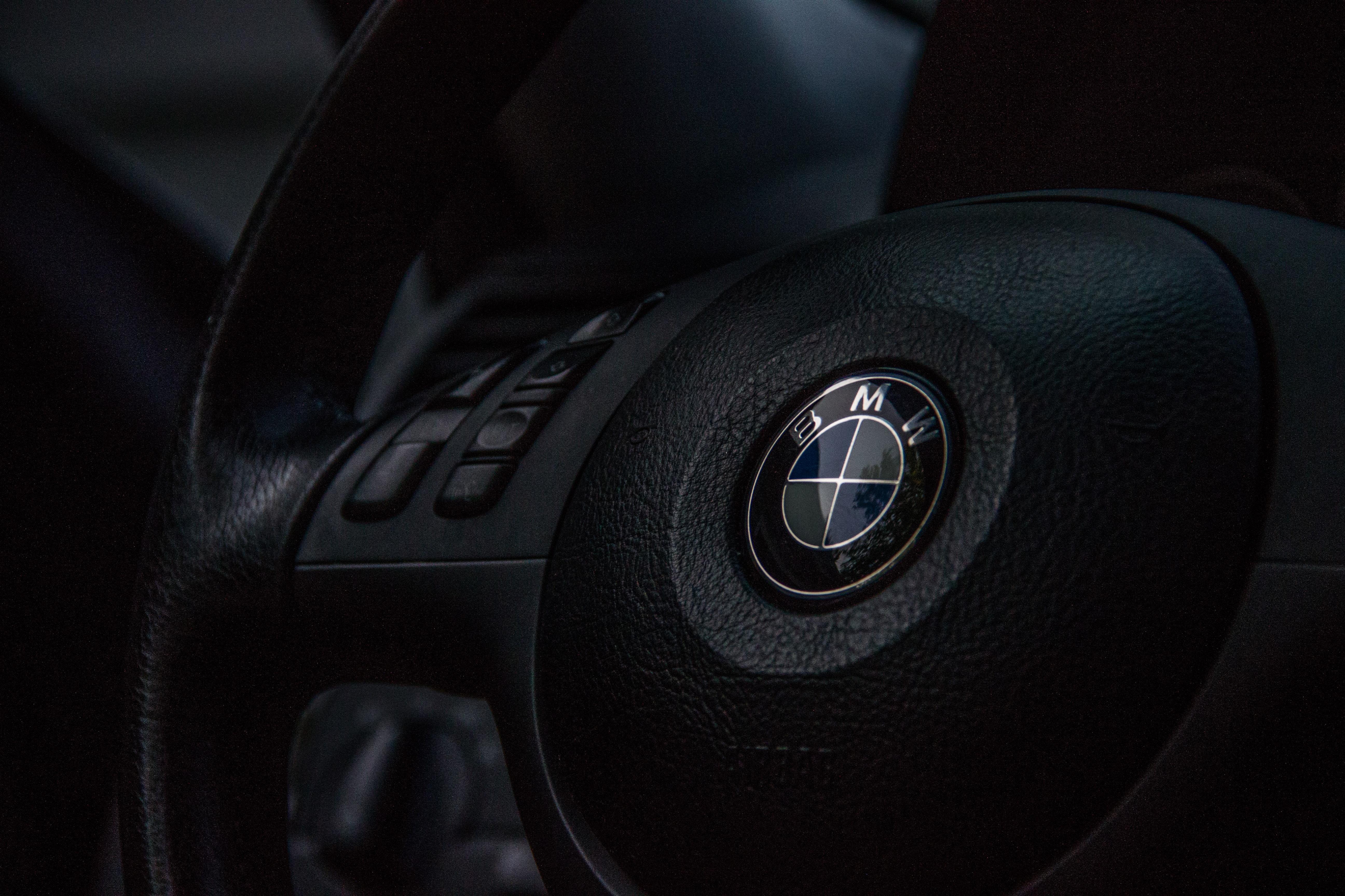 Macro vew of a black BMW steering wheel