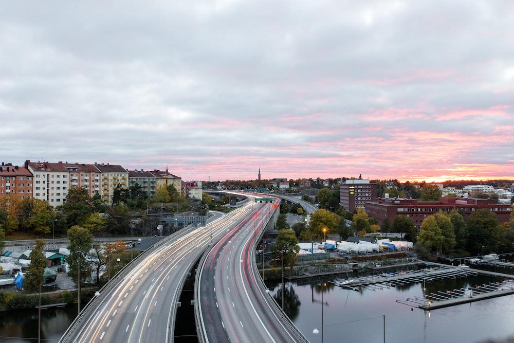 aerial photograph of concrete bridge road in city