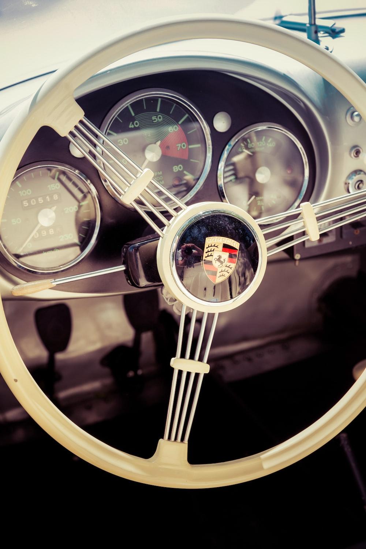 closeup photo of white car steering wheel