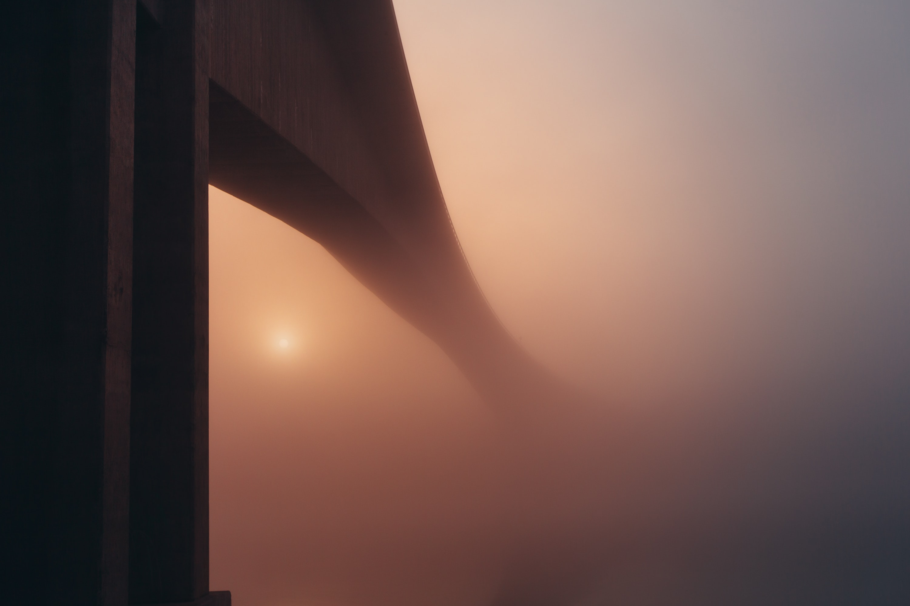 Bridge disappears into mist on a foggy day in Stockholm