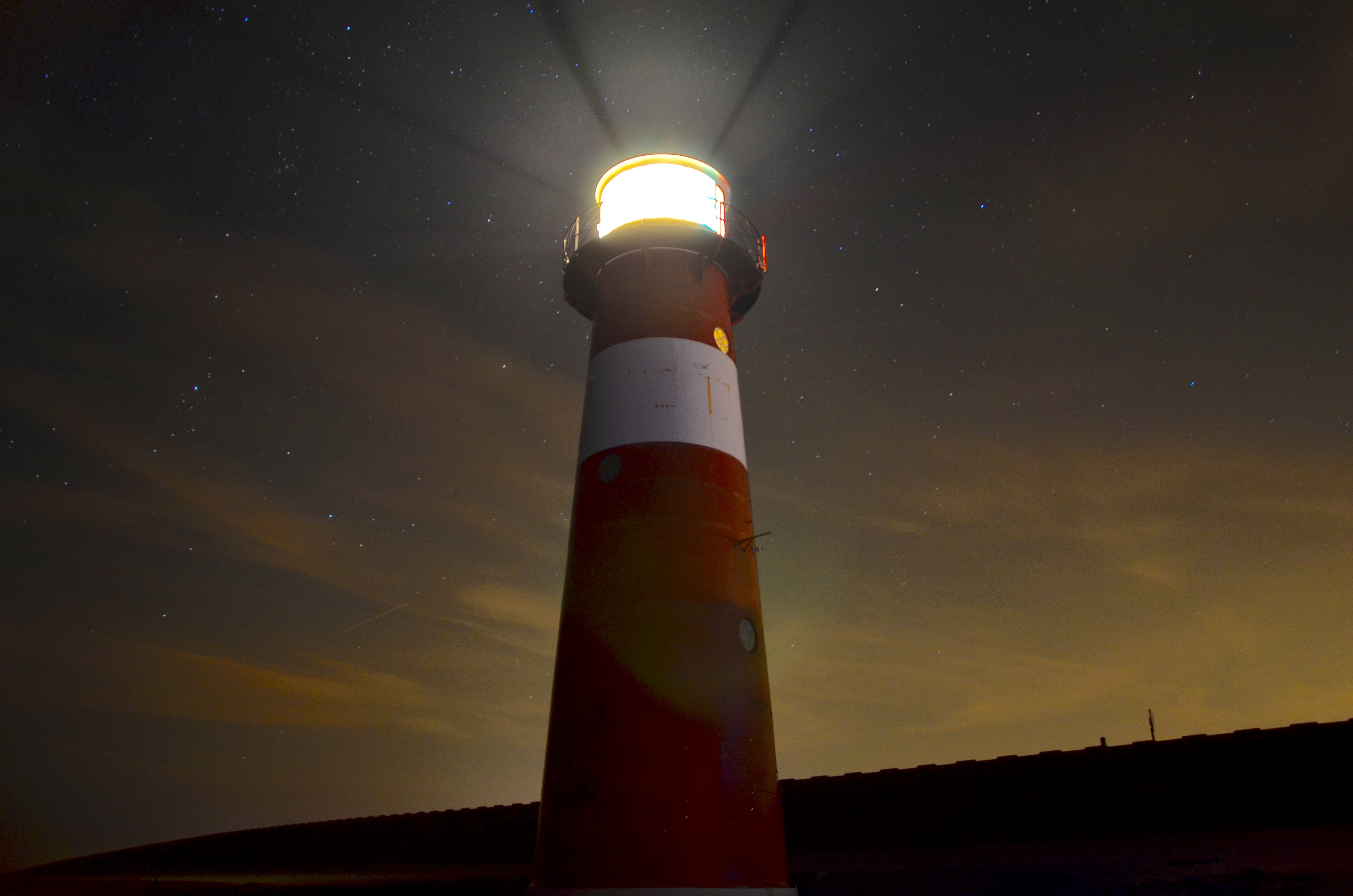 low angle view of red and white lighthouse
