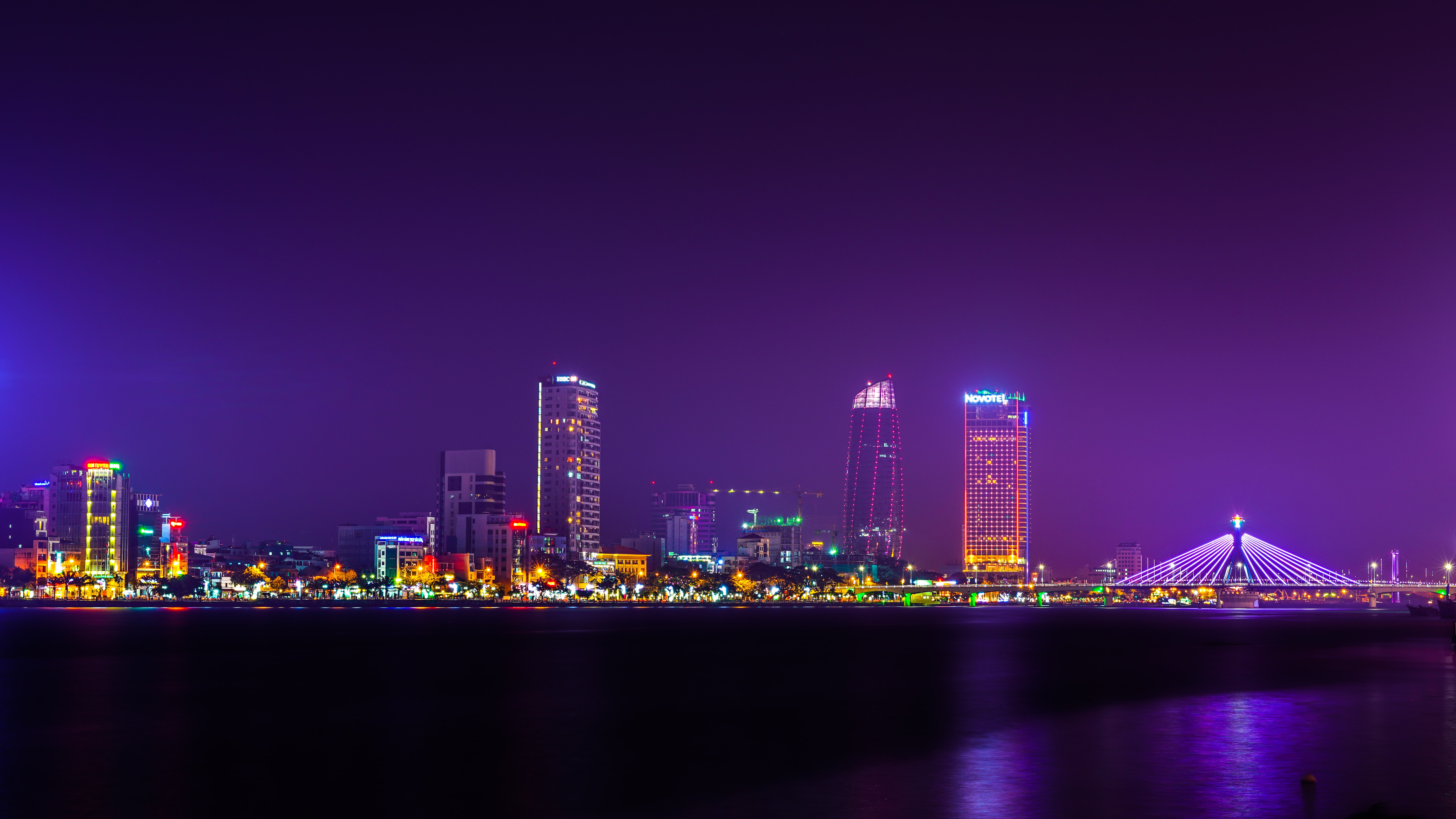 The bright skyline of Da Nang in Vietnam seen from the river at night