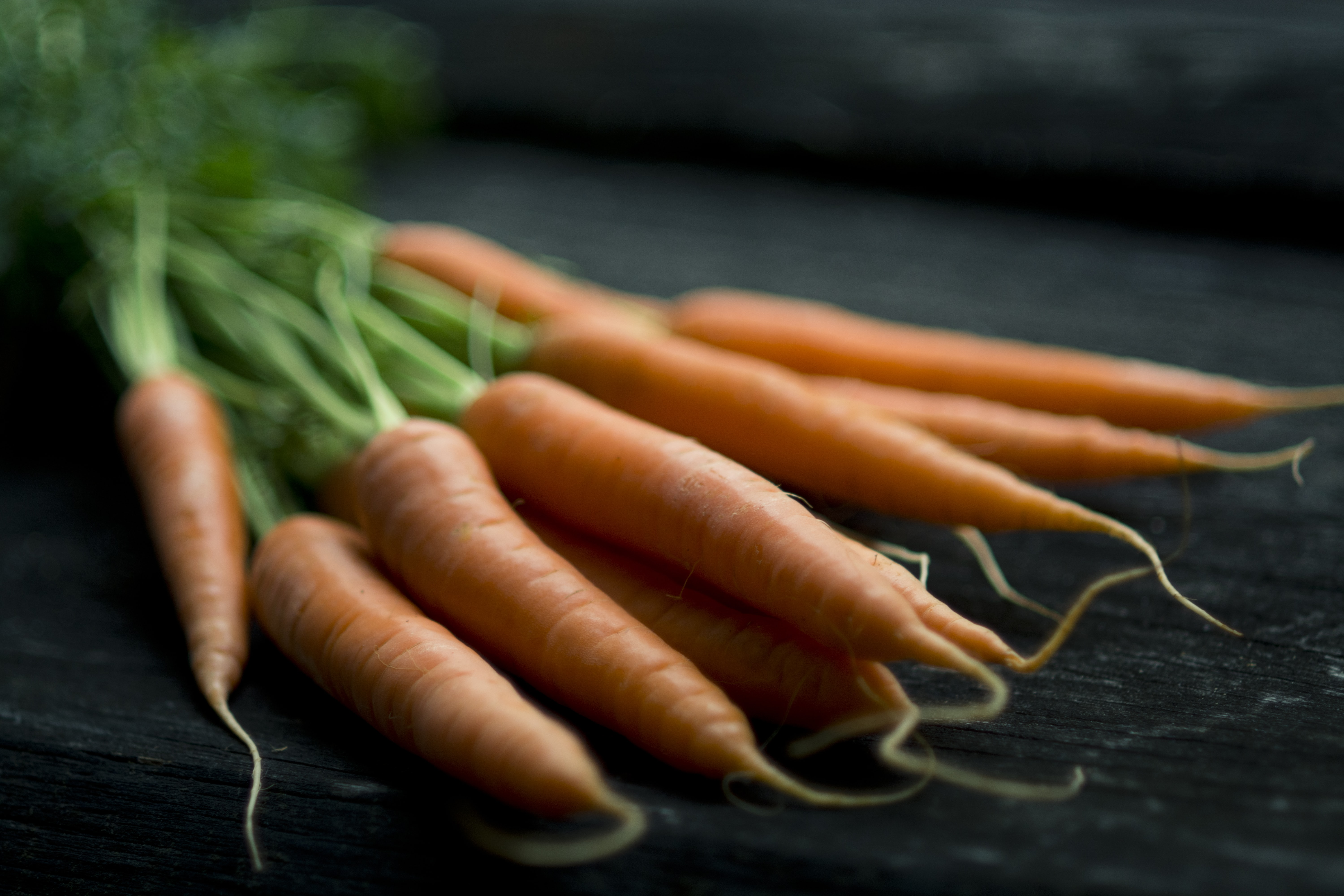 Carrots laying on a table in Wien