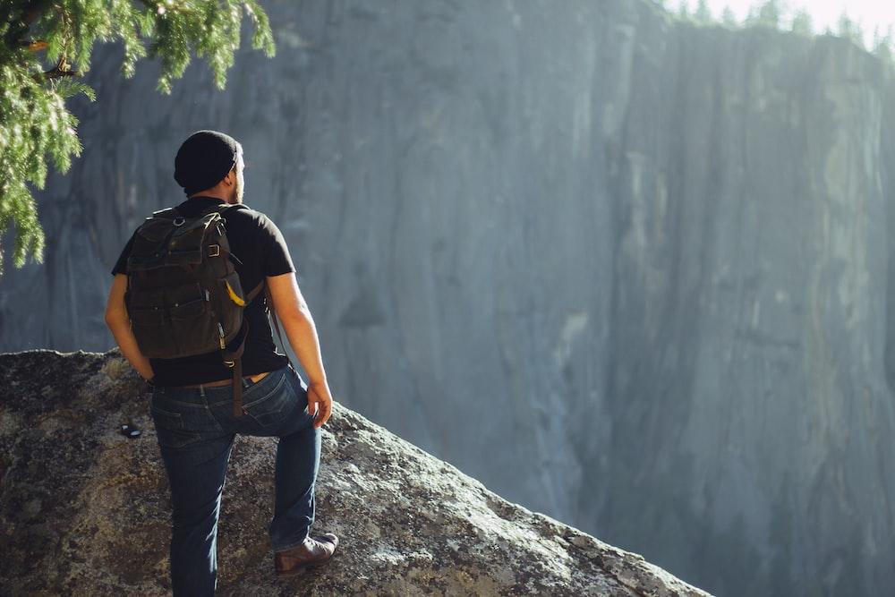 man standing on gray stone