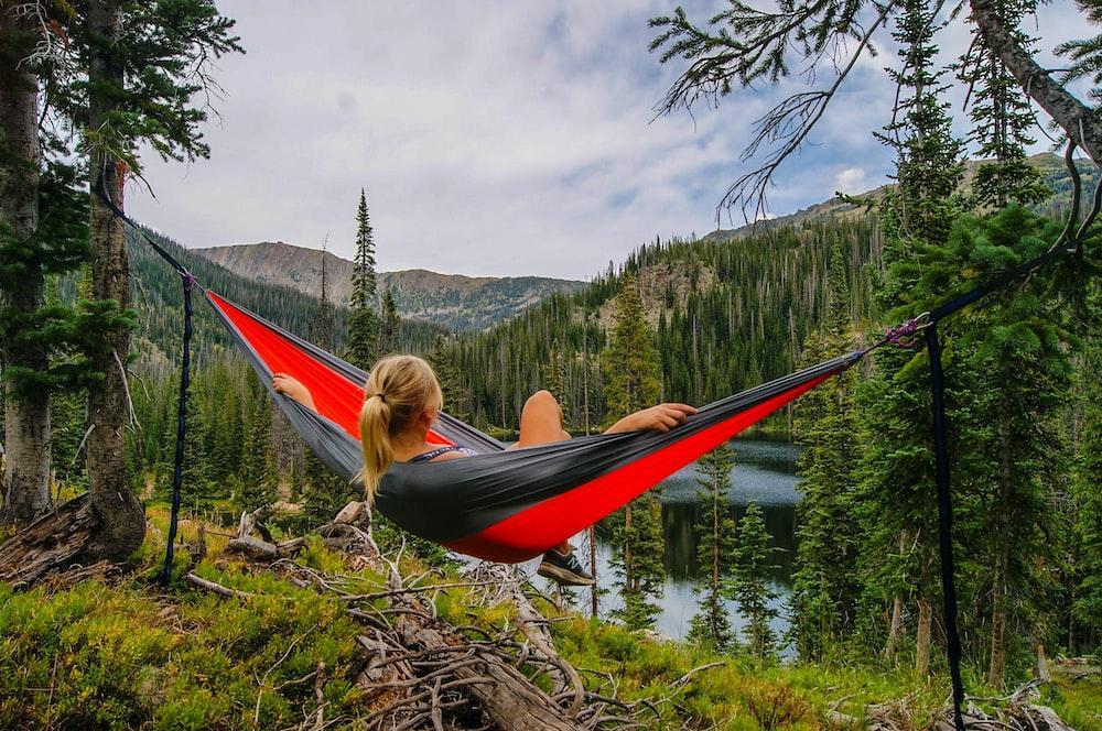 woman on hammock near to river