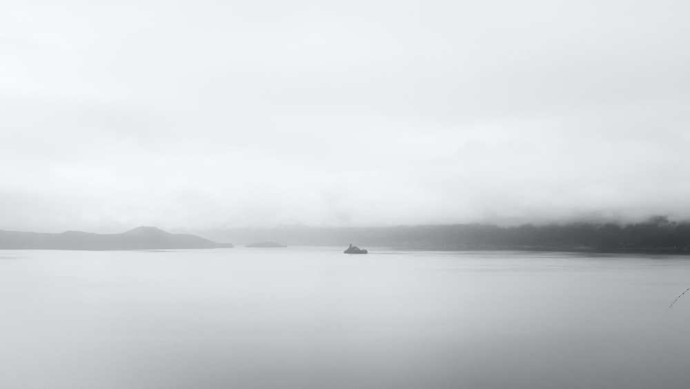 grayscale photo of a body of water