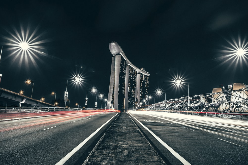 time lapse photo of road near Singapore Marina Bay Sands