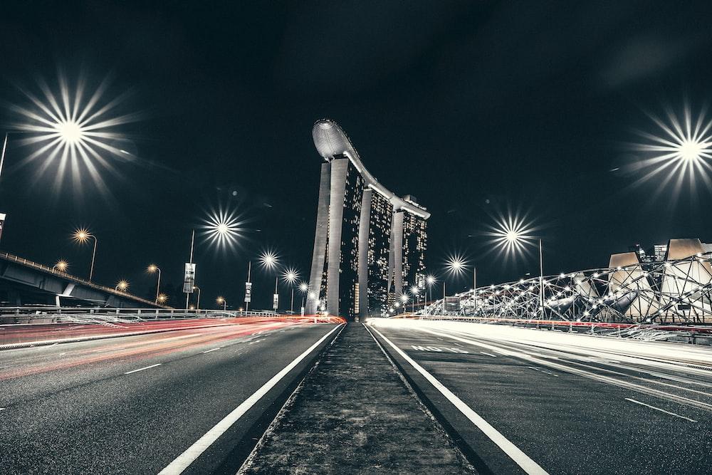 time lapse photo of road near Singapore Marina Bay Sands