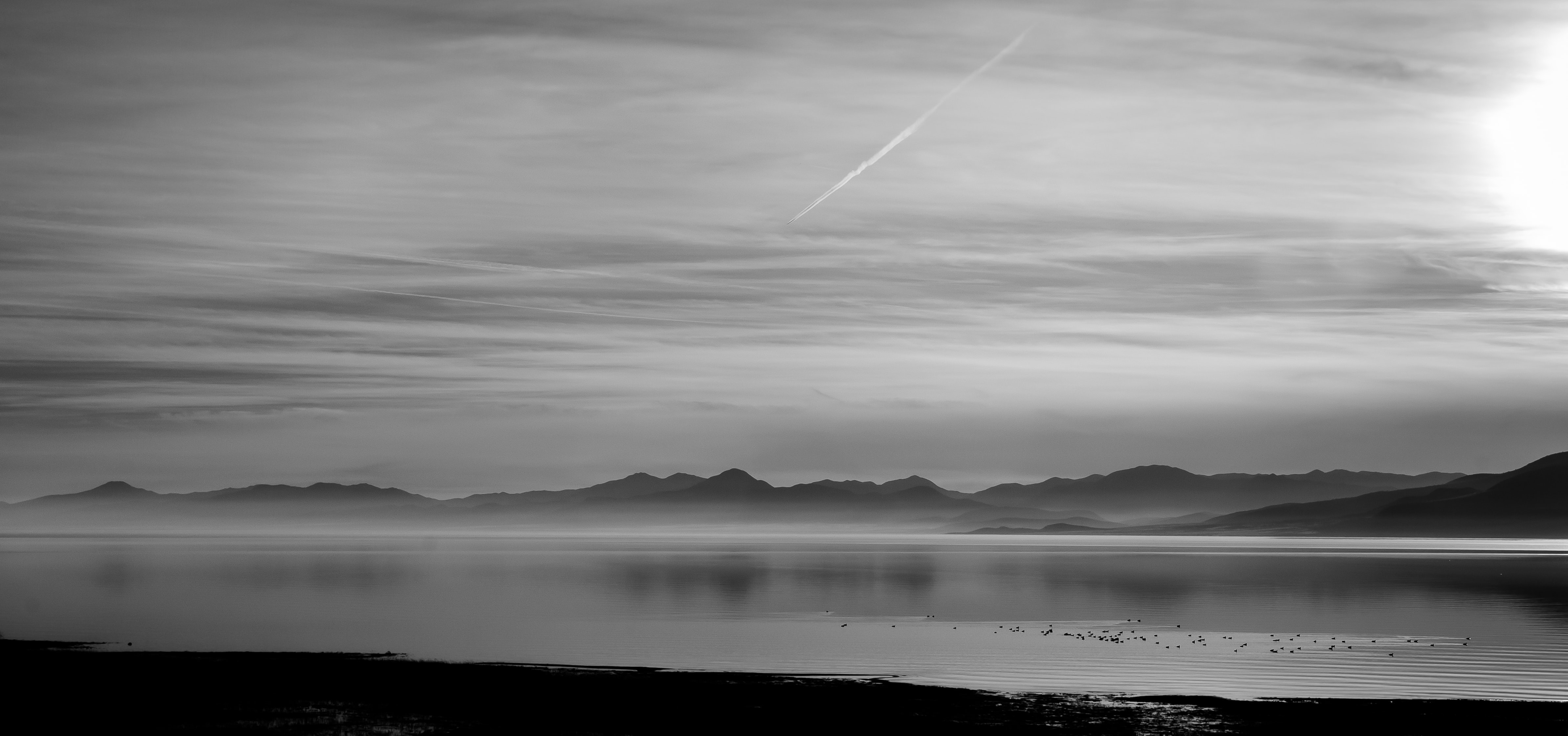 grayscale photography of ocean and island