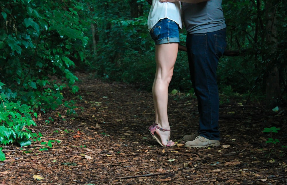 two person facing each other surround by trees