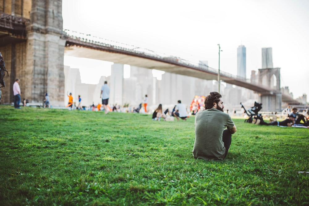 men's gray crew-neck t-shirt sitting on the grass