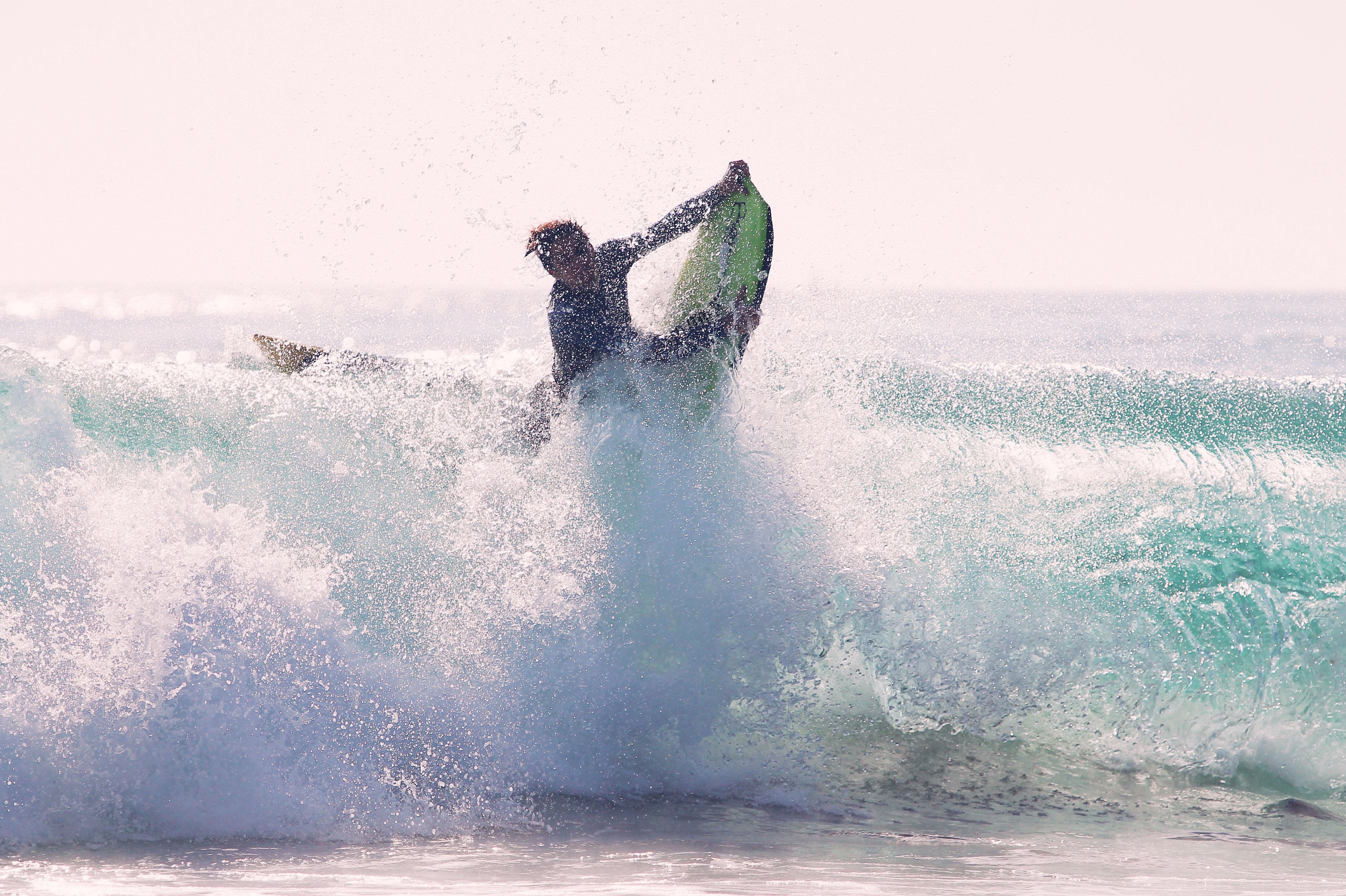 man riding bodyboard