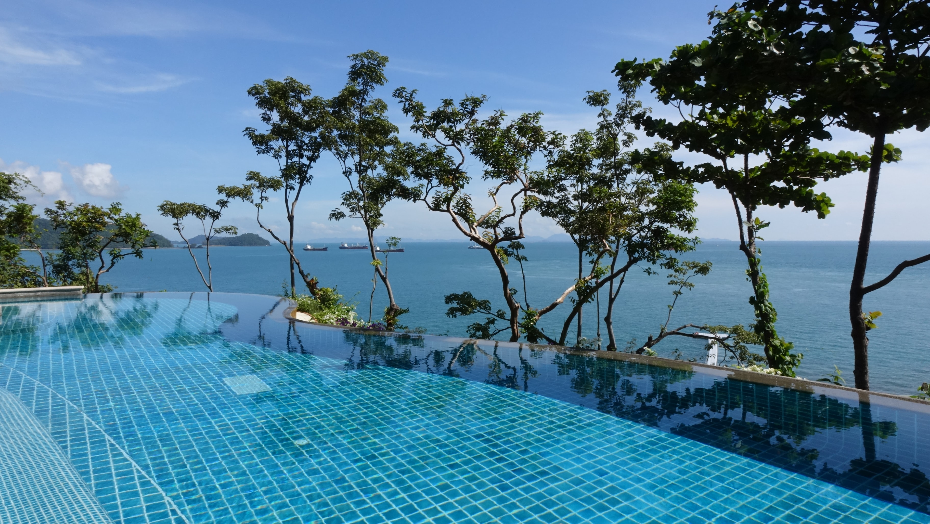 infinity pool with background view of open sea at daytime