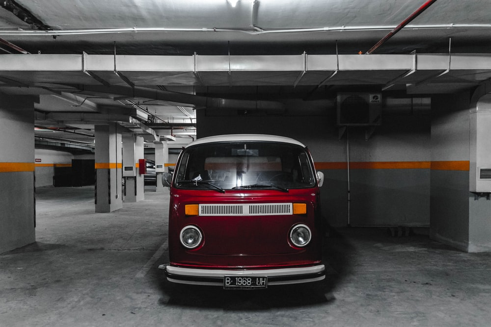 white and red car parking on parking lot