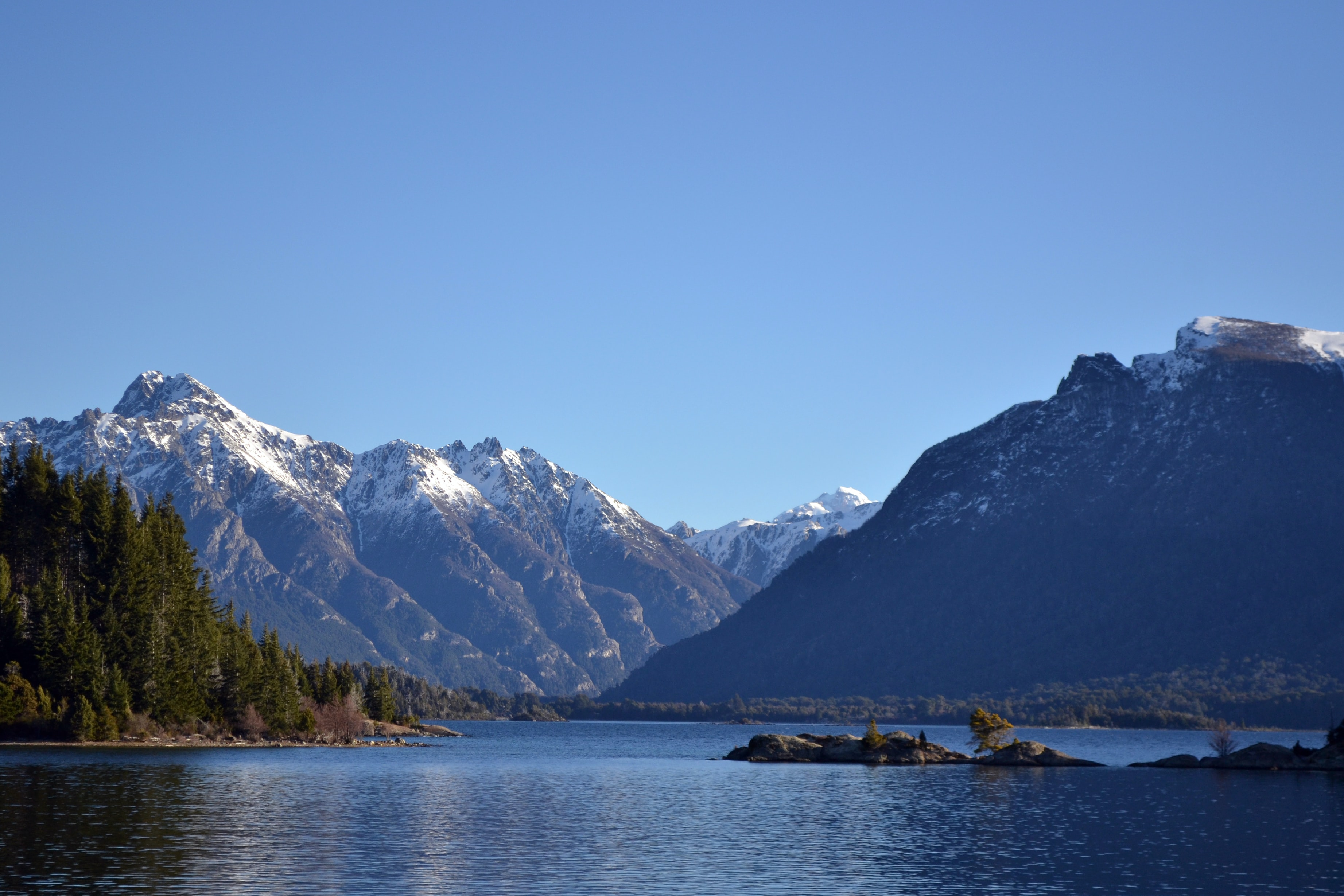 A lake at the foot of snowy mountains in Nahuel Huapi