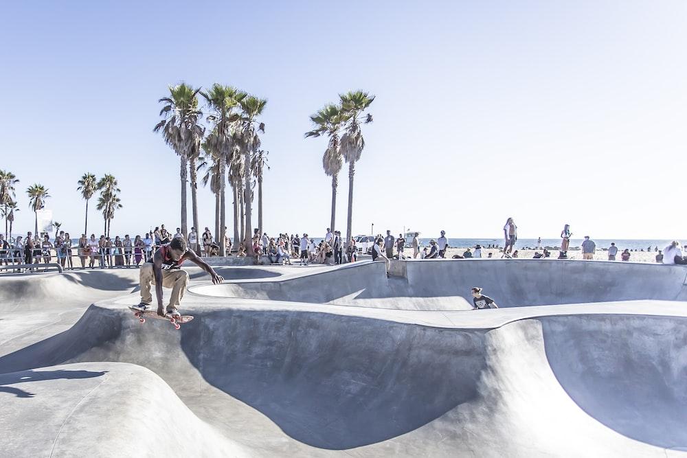 man playing skateboard doing tricks