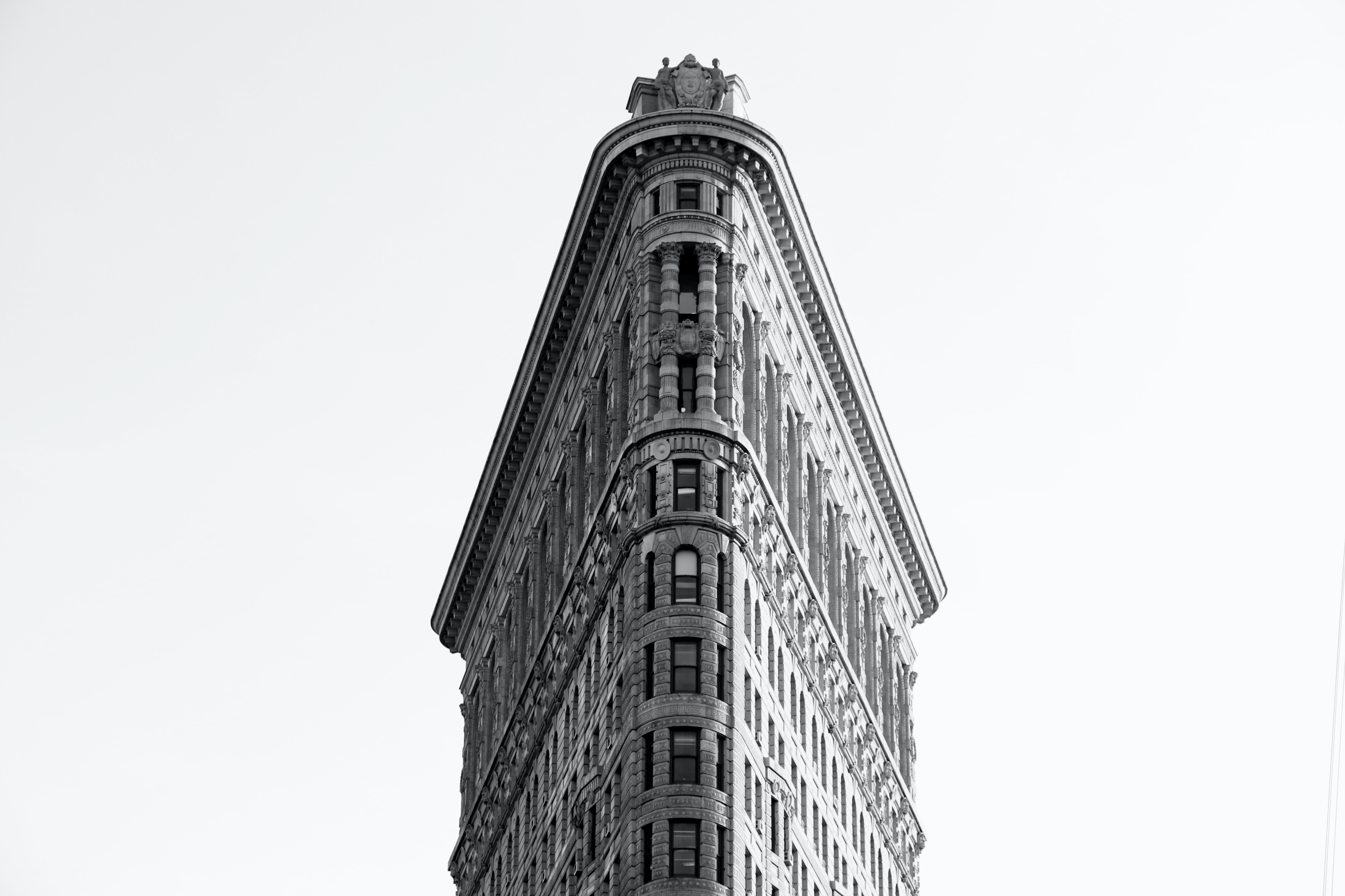Black and white photo looking up at the Flatiron Building in New York City