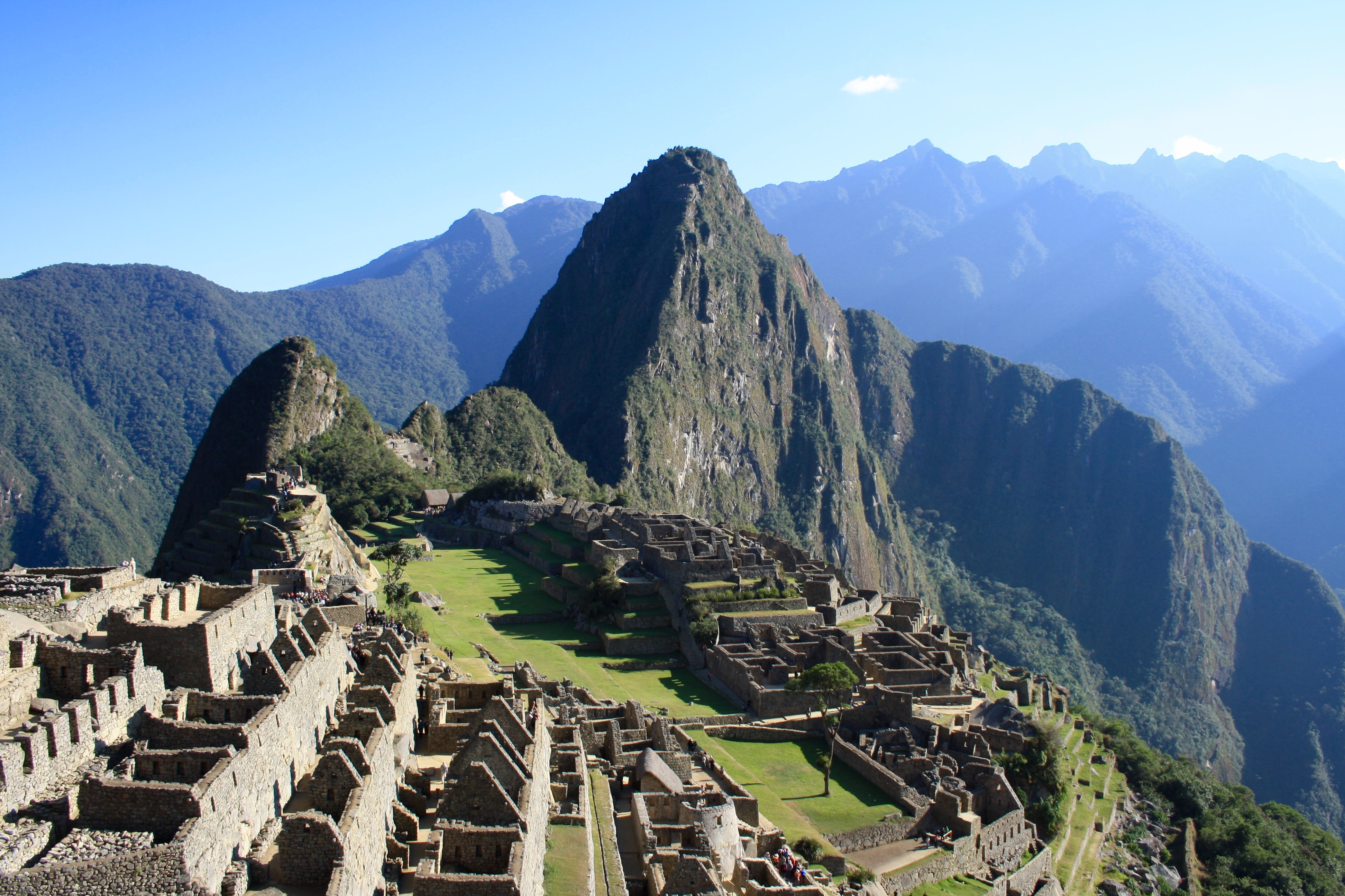 A mountain ridge with the ruins of Machu Picchu on a sunny day