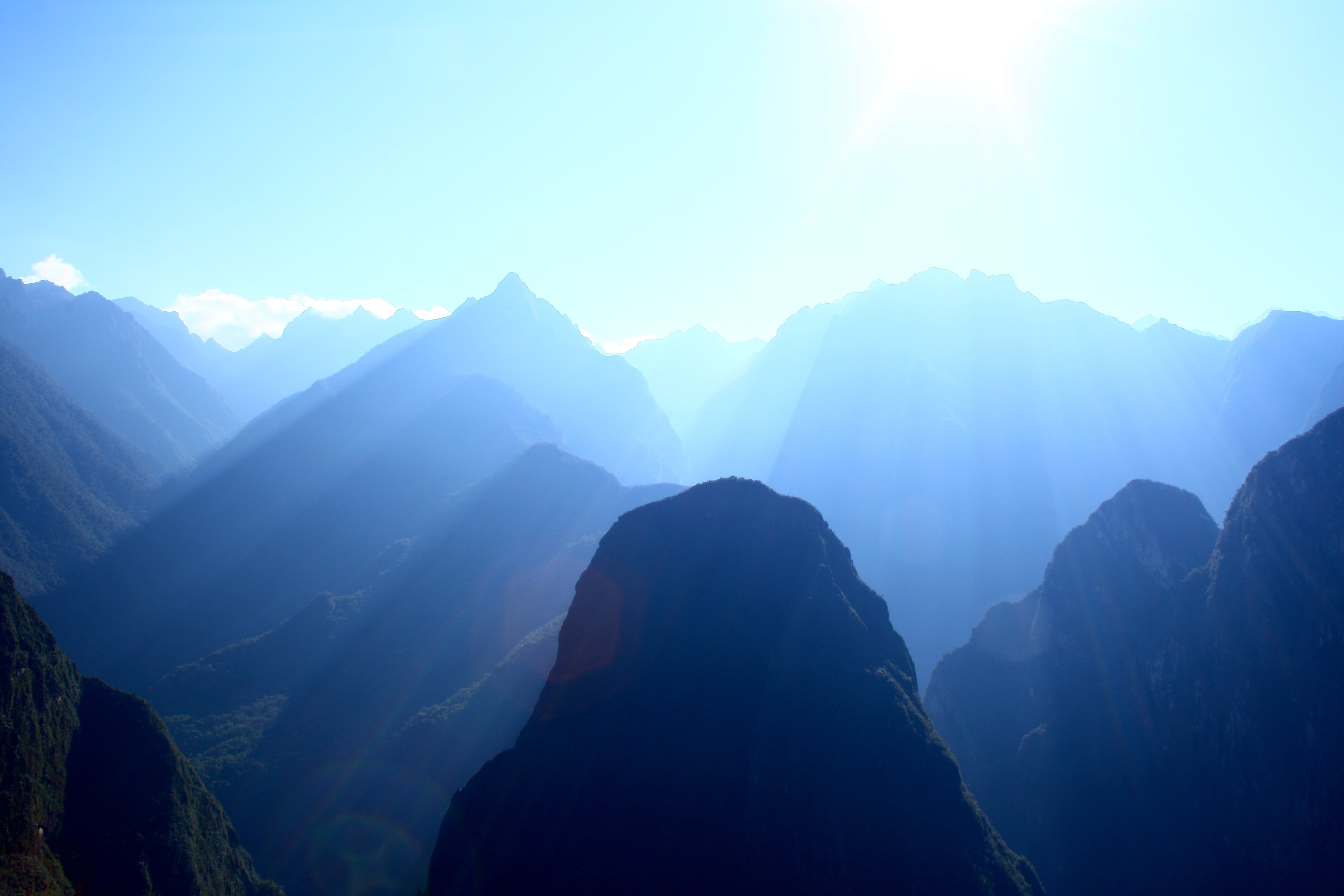 Sunlight fills green mountain valleys near Machu Picchu