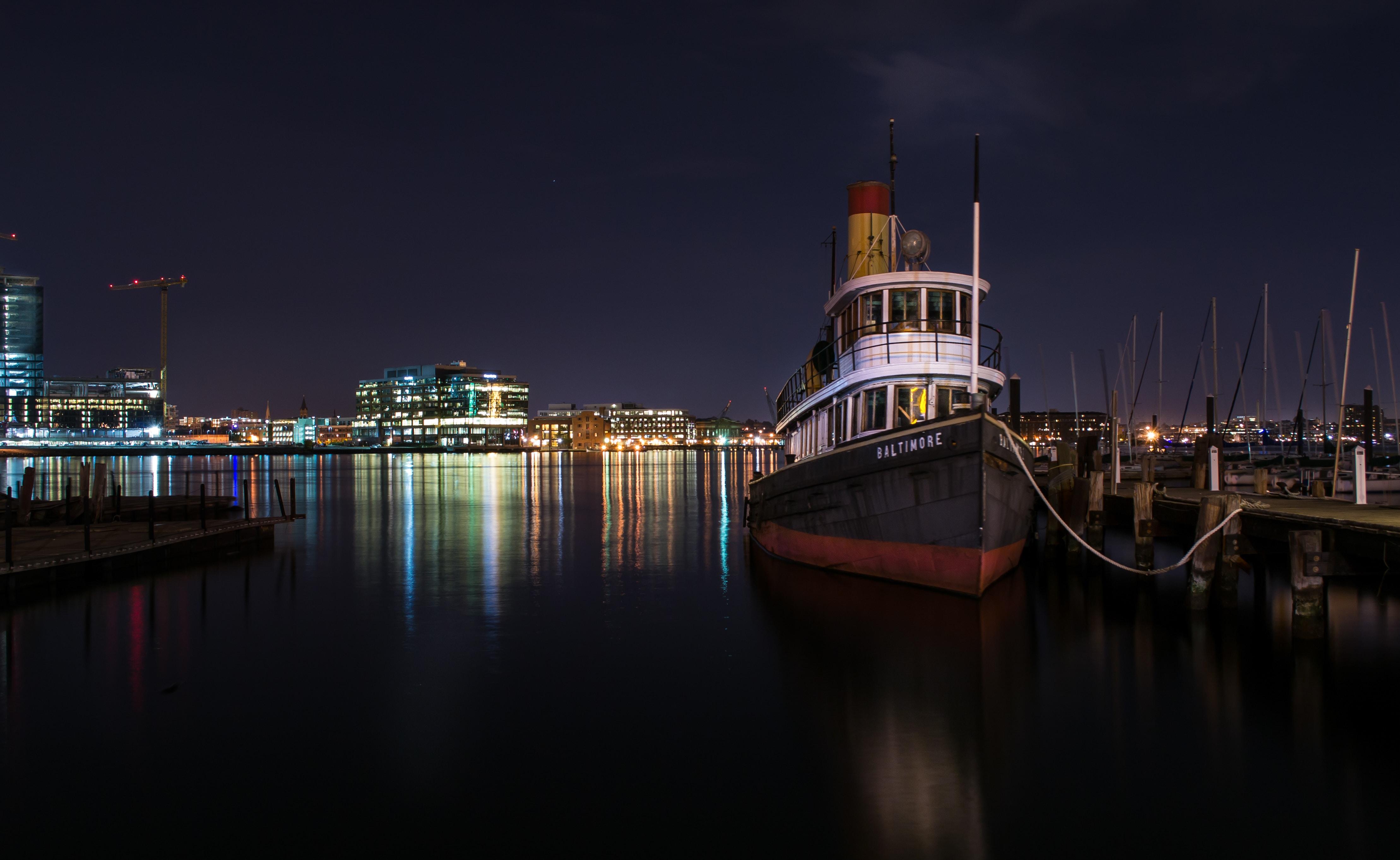 black boat tied on beach dock