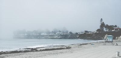 sea shore and sea waves near town santa's elves teams background