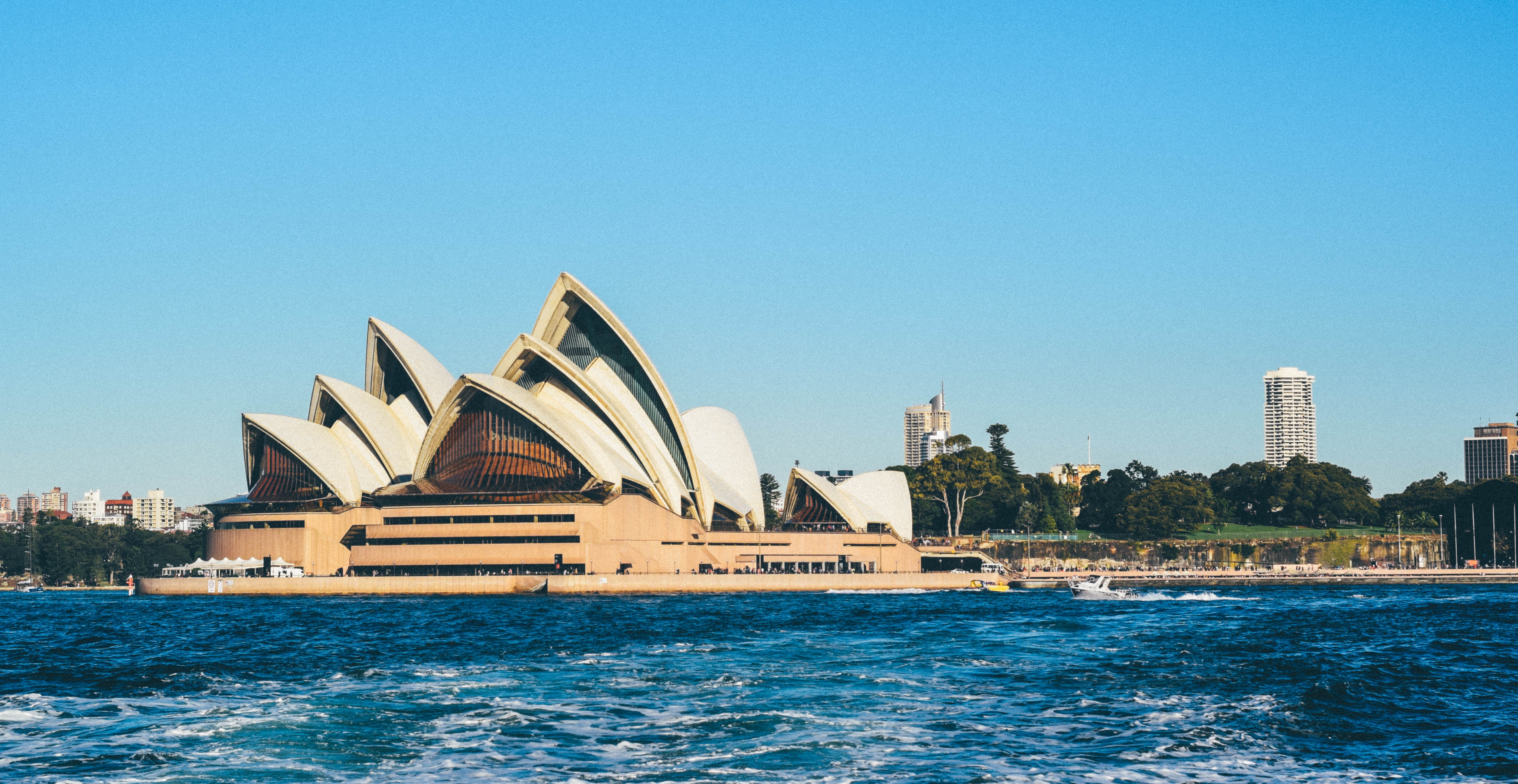 The building of the Sydney Opera House seen from the water