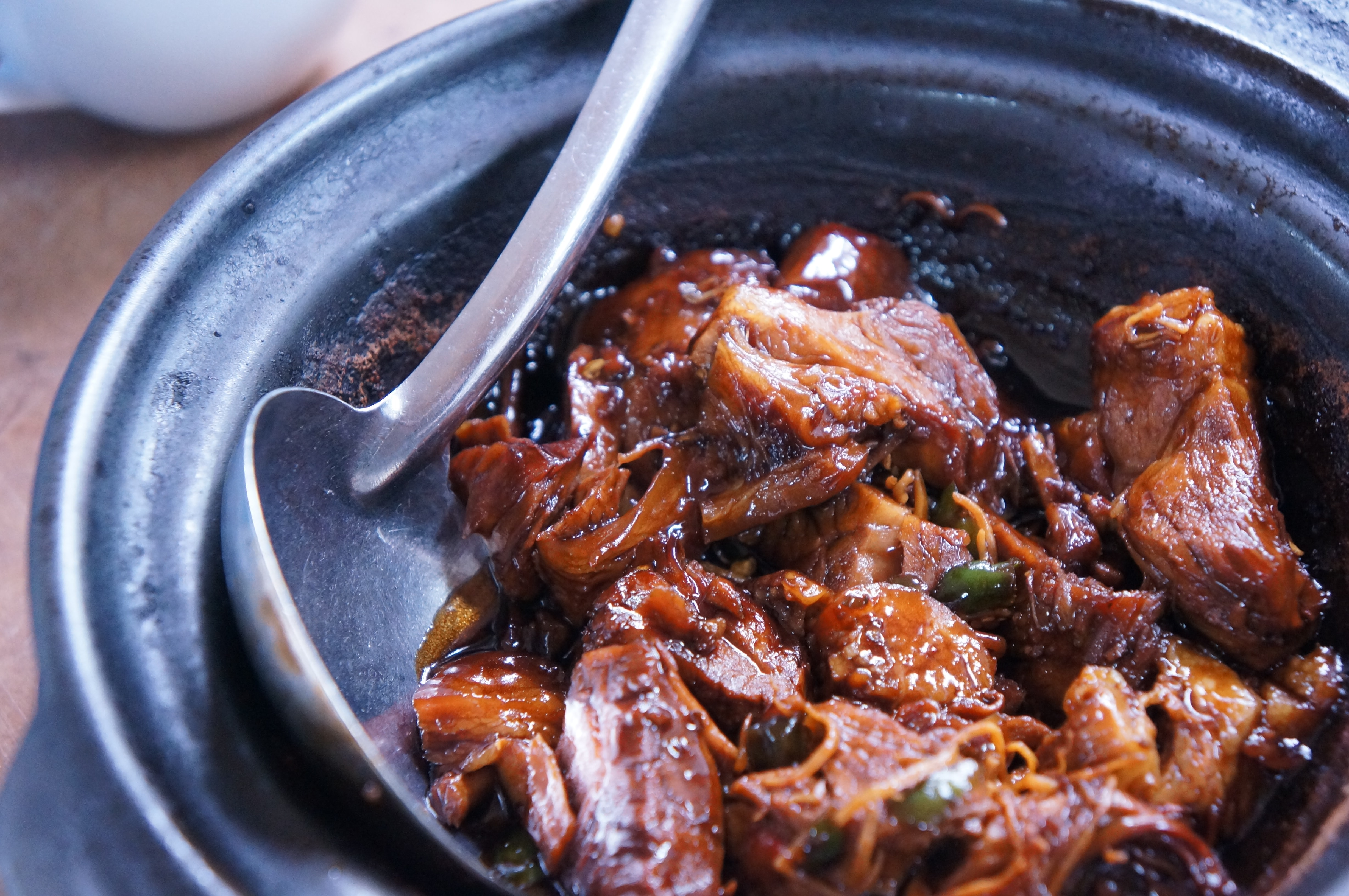 Stewed meat in a bowl with a spoon in Klang