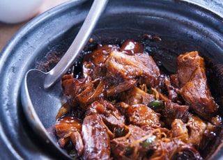 meat with sauce in black bowl