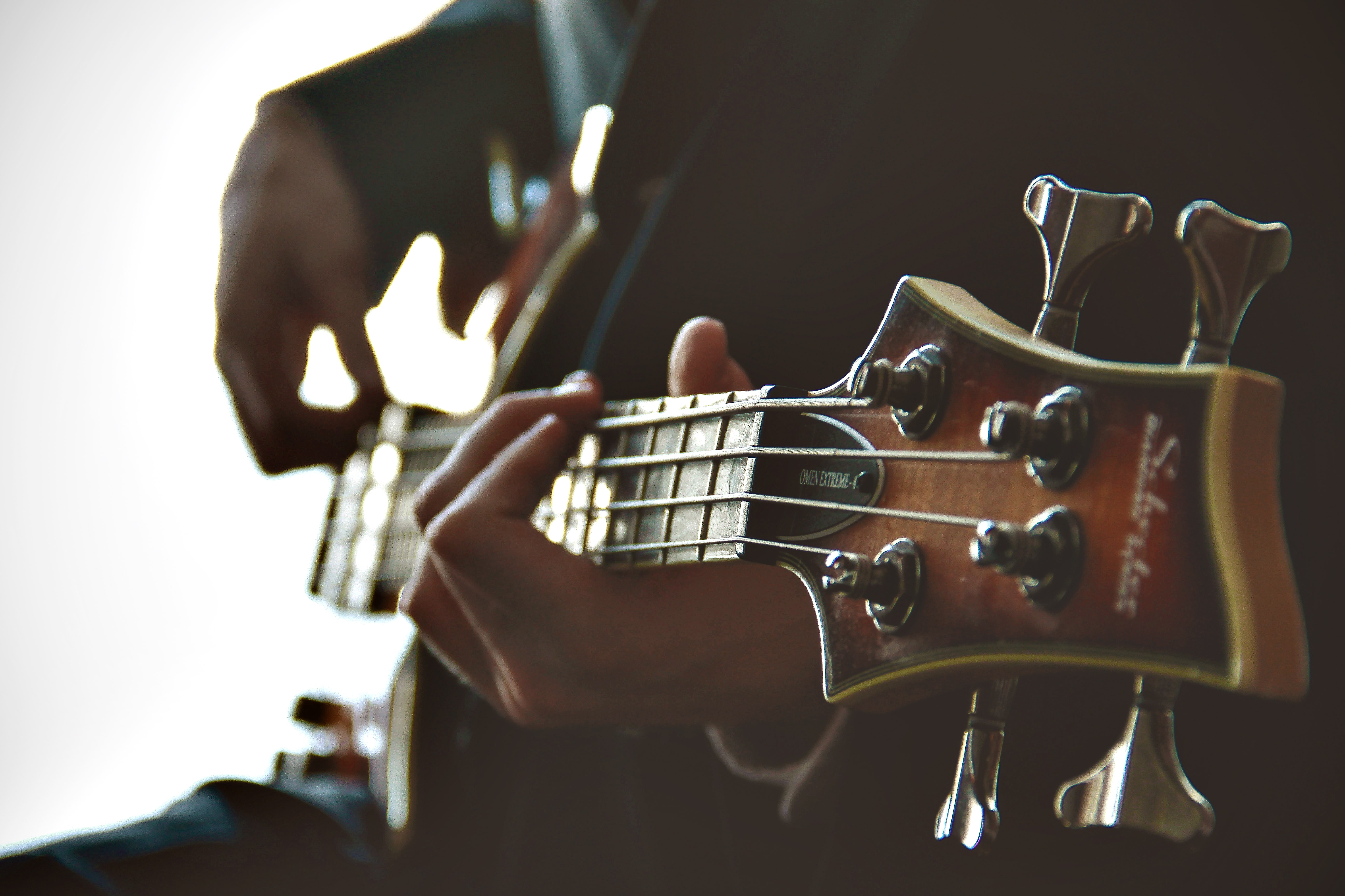 A close-up of a person's hands strumming the guitar