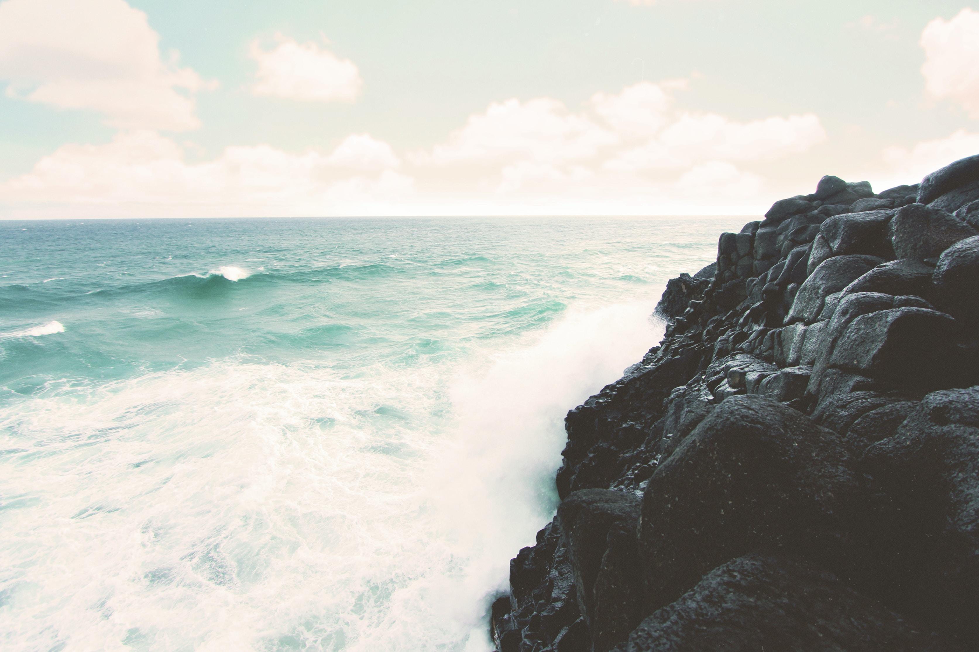 rocky cliff beside the ocean