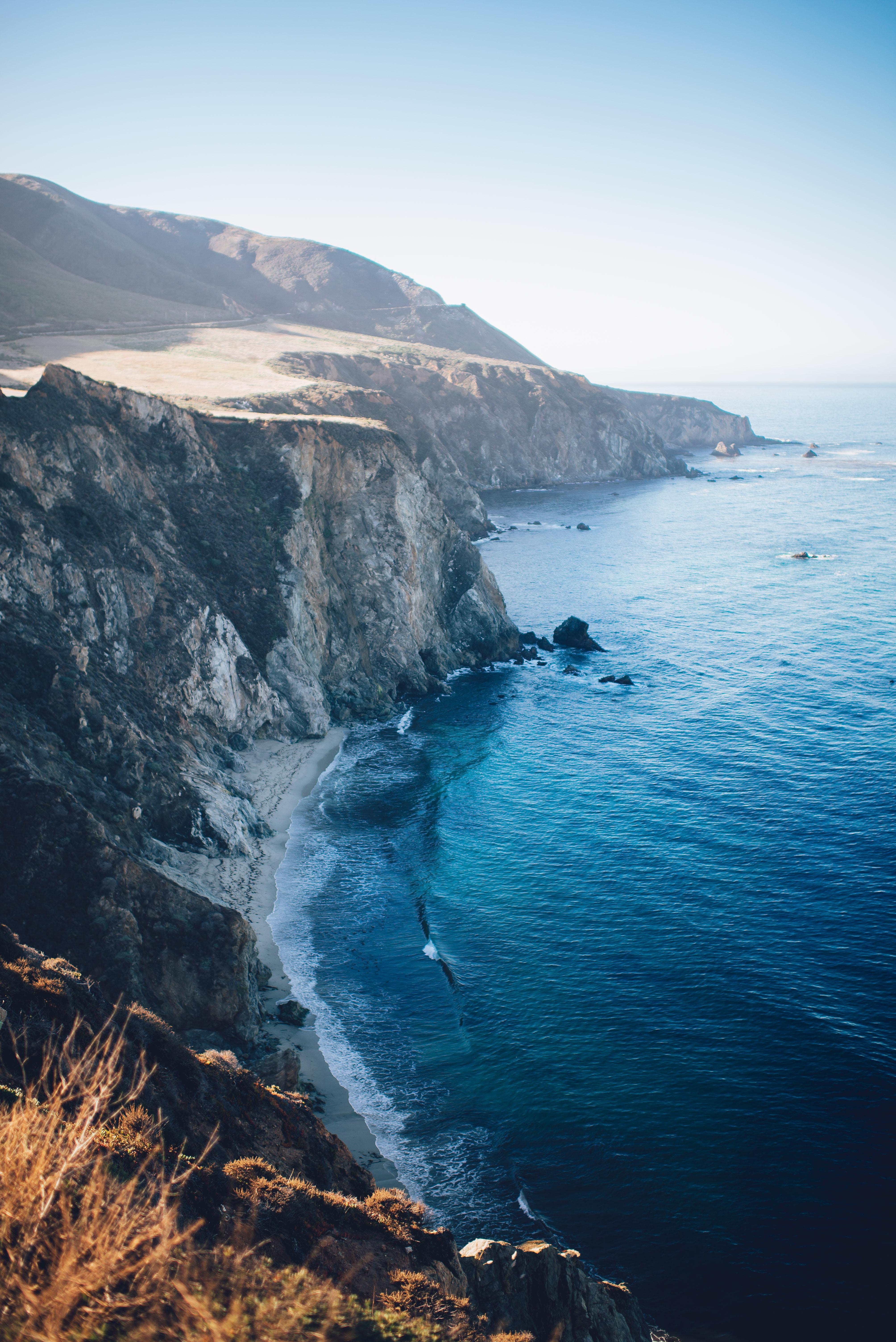 photo of cliff near shore