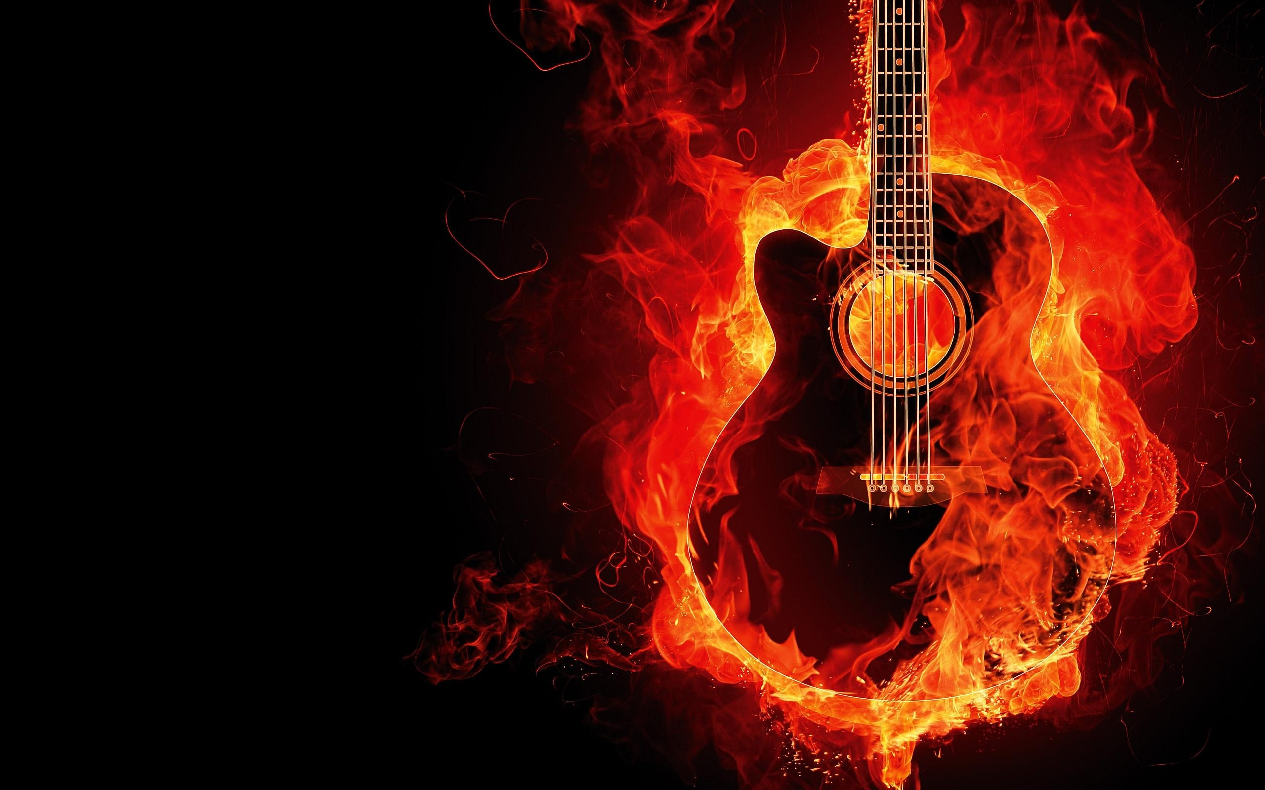 A cutaway acoustic guitar in flames against a black background