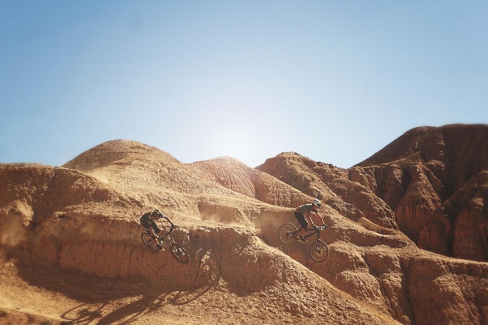 photo of bikers on mountain