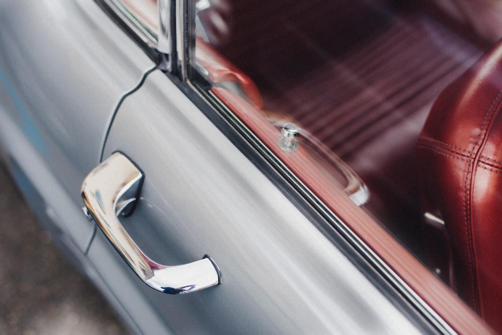 selective focus photo of gray vehicle door handle