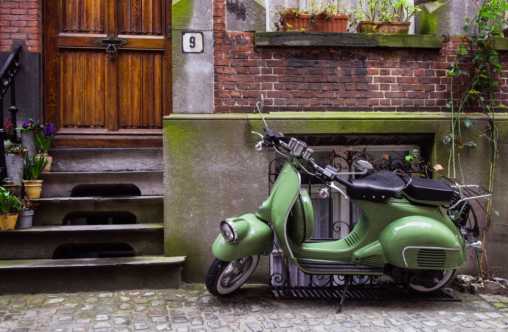 motor scooter parked near house