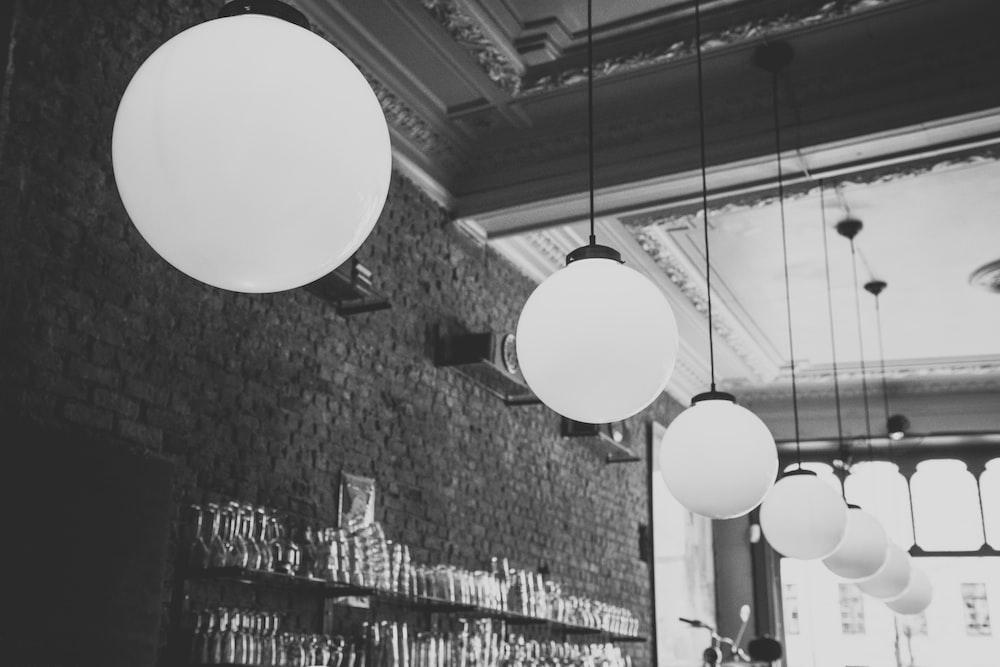 grayscale photo of pendant lights