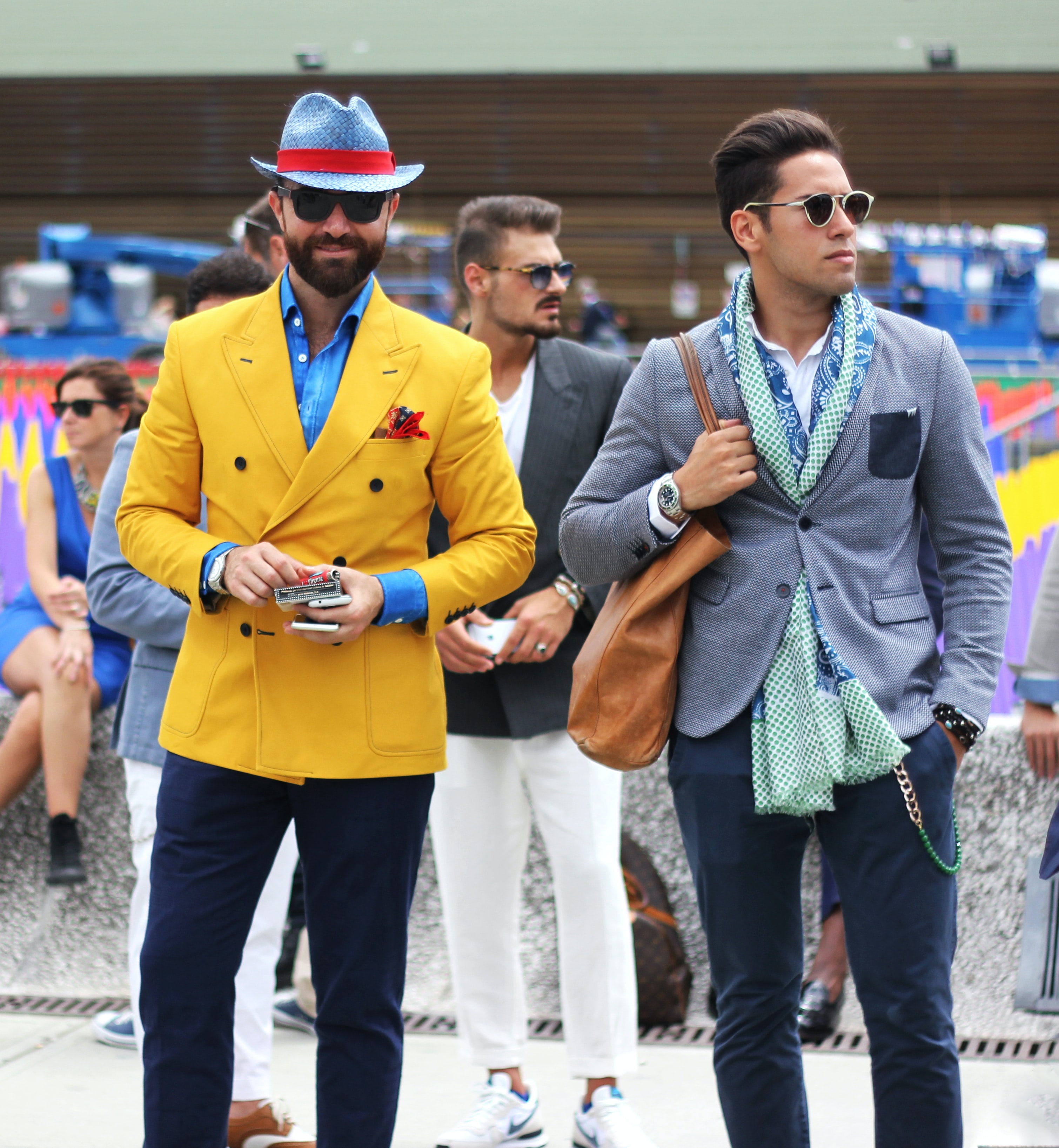 Men in colorful suits standing fashionably at Fortezza de Basso